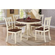 This blushing dining set design of cottage decor is filled with light and airy color accented with rich dark hues. The round cherry wood table top is trimmed in an off-white frame with beautiful embellished legs.