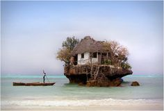 The one and only Rock Restaurant rises on a rock not distant from the shore of the beautiful Michanwi Pingwe beach - Zanzibar (island on Africa´s east coast). The Rock is an extraordinary seafood restaurant, depending on the tide, you can go walking, swimming or even by boat. There, the seafood is always fresh. If it´s in your plans to stop there, book early, because the restaurant only has 14 .