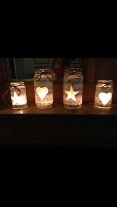 Tea light votives - made using recycled jam jars and old sheet music and decorated with gardener's twine and glitter.
