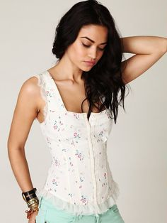 delicate feminine corset tops are so pretty, especially underneath a high-waisted skirt.