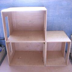 Simple plywood roomboxes can be joined or placed in a cabinet to form an expandable dolls house.