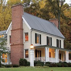 Love this new home that looks like old. Love the two chimneys.
