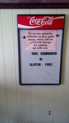 99 Funny Signs-  This sign is gluten free hahahahah i bet that is the only gluten free thing at that restaurant.