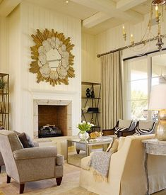 Suzie: DeCesare Design Group - Chic living room design with high ceiling.  Love the natural feel of the room with the wood starburst.