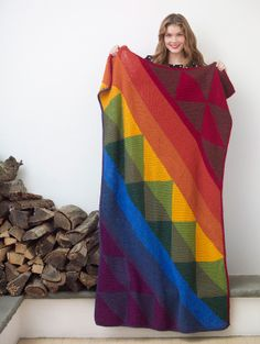 This knit afghan will always have you thinking of rainbows, rain or shine.