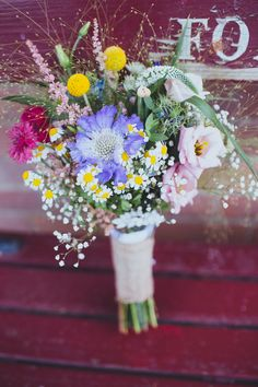 Vintage Colourful Windmill Wedding Wildflower Bouquet Daisies http://www.gavinphotography.co.uk/