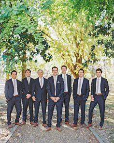 A Refined, Rustic Nashville Wedding | Martha Stewart Weddings - Barry and his groomsmen wore navy tuxedos from The Black Tux with taupe ties and matching pocket squares.