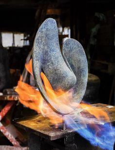 Bronze sculpture getting its patina. Jan van der Laan at work, november 2016