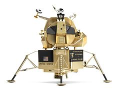 Cartier Apollo 11  - A solid-gold replica of the 1969 Lunar Excursion Module headlines a space-age exhibition