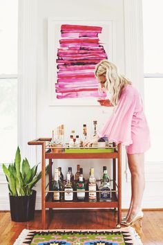 LOVE this painting in the background!  Style Muse-Mad Men! (click through for more inspiration)