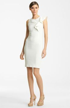 Sheath dress with single bold bow..