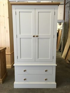 Bespoke Larder cupboard painted in F&B All White with Oak top and knobs. www.cobwebsfurniture.co.uk