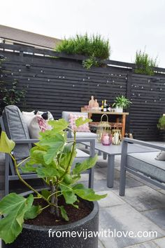 Garden Patio Area makeover, custom built black wooden privacy screen, grey slabbed area. Garden Slabs, Fence Lighting, Large Planters, Amazing Spaces, Outdoor Furniture Sets, Outdoor Decor, Diy Patio, Decking, Beautiful Space
