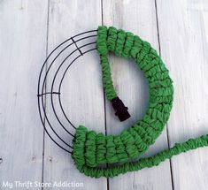 Leaky garden hose? Instead of tossing it, repurpose it as a whimsical garden wreath!