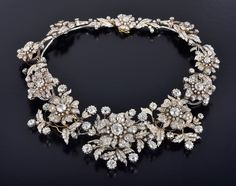 A very impressive Victorian 'En Tremblant' necklace with over 100cts of diamonds. In the original box are fittings to take the necklace apart, forming brooches and earrings. Signed 'Petochi'
