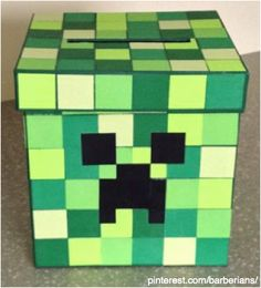 Valentines Day Minecraft Creeper Box made from a craft box that has been spray painted a base of green. Added scrapbook paper cut into squares and duct tape face. Big hit! https://www.pinterest.com/barberians/