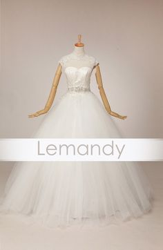 high neck cap sleeves princess tulle wedding gown lace-up back. $245.00, via Etsy.