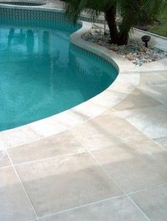 Travertine pool deck Melbourne - tropical - Pool - Orlando - Concrete Designs of Florida
