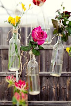 Strip off the label for wine bottles, hang twine around their bottleneck and hang in your garden for your next backyard party.
