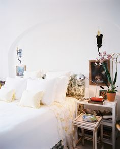 Bedroom art doesn't have to live above the bed, as evident in this all-white space.
