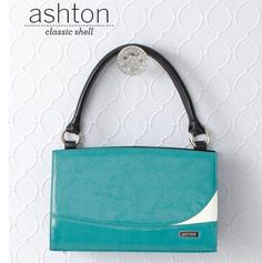 "Ashton    Unique patent turquoise faux leather makes the Ashton a delightful addition to your Miche Classic Shell collection. She evokes dreams of afternoons sailing on crystal-clear waters and cocktails at the country club—but really—her sophisticated styling makes her the perfect choice for any setting! Note the stylish ""white wave"" accent—you'll get compliments wherever you go . . .     https://purse-divas.miche.com/Shop/Product/1190"