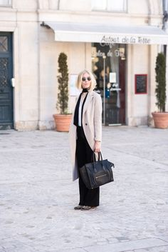Beige wool coat with a skinny scarf and Céline mini luggage