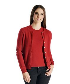 Product review for Women's Cashmere Cardigan Twin Sweater Set.  This is a pure cashmere cardigan twin set for women. The inner sweater has a round neck with short sleeves, whereas the outer cardigan is a button down style with long sleeves. Luxurious, soft and really warm, our sweaters are made from the finest grade of cashmere wool. These sweaters are made...