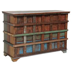 Reclaimed wood storage chest with multicolor detail and raised stripe overlay.   Product: Storage chestConstruction M...