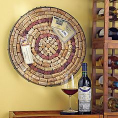 A repurposed steel wine barrel hoop with a recycled wood backing. Add your corks. Wine Barrel Hoop Cork Kit - Wine Enthusiast