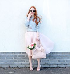 pink chiffon skirt with grey floral sweater and heels