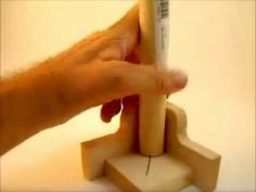 Make a jig  for finding the center of wooden dowels.  Clever.......D.