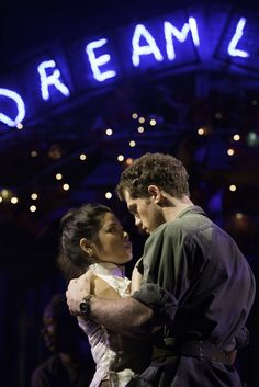 Eva Noblezada as Kim and Alistair Brammer as Chris in the 2014 revival production of Miss Saigon