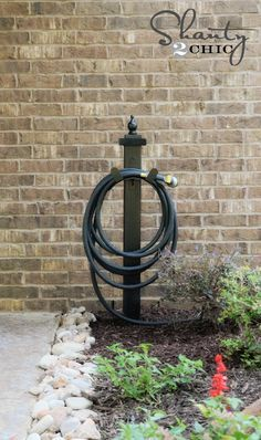 DIY Garden Hose Holder -- I've been wanting one of these and it's so much cuter than the store bought kind!
