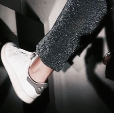 Shimmery pant, white Stan Smith sneakers.