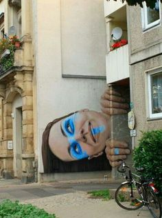 Blake DeLong- woman's head versus size of building reflects artist's visual effect using scale