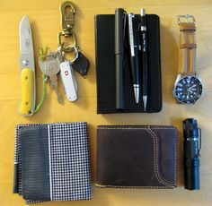 submitted by beyadika Here is the typical load out for me:-Fallkniven U1 Slipjoint knife, smooth bone handle, 3G steel-Keys with Photon light and Alox Swisschamp-Notebook, Lamy Fountain Pen, Cross Rollerball pen, and 0.5mm Pentel Pencil-Seiko skx007 on leather strap-Handkerchief-Vagabond Traveler Leather Wallet-Fenix LD10, great single AA flashlight Editor's Note: Nice, full loadout. I can see you have multiple tools (pens especially) for specific tasks. The redundancy here also serves to…