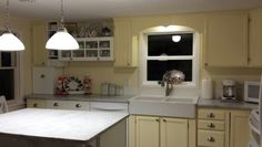 Love it! So far the costs for appliances: stove, hood, fan, dishwasher, sink & faucet w/installation - $2800. A few new Ikea cabinets and others, marble, paint, hardware, trim - $5500.  Floor for only the kitchen area  - $2500.  Yep - over $10,000.   The total in labor paid out was about $2400 .  Big thanks to Bill, Ken & John for their support and skills!
