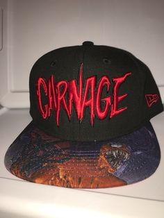 New era marvel snapback Carnage with Carnage character on brim red under brim with small carnage head on the side