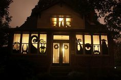 Halloween Window Monster Silhouettes! This came out awesome! So far we made one, can't wait to do the other windows!