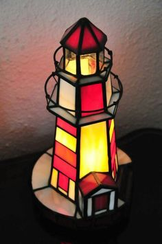 Vintage Stained Glass Lighted Lighthouse by NancysGeneralStore Stained Glass Light, Stained Glass Suncatchers, Stained Glass Designs, Stained Glass Projects, Stained Glass Patterns, Stained Glass Windows, Leaded Glass, Mosaic Glass, Lighthouse Lamp