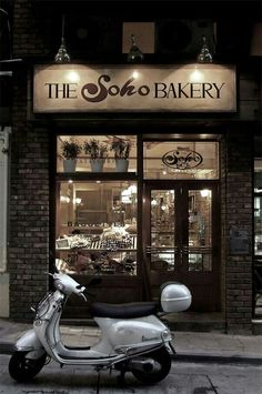 Somehow a vespa scooter just completes the look of any bakery.....not sure why