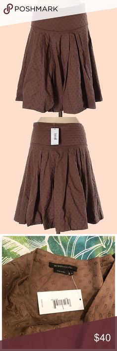 BCBGMaxAzria Brown Embroidered Circle Skirt SZ 2 Skirt is by BCBGMaxAzria and is a size 2 It's a medium brown color with embroidered detail throughout  Skirt has a side zipper closure, pleating at the front and back, and a wide waistband. Hits just above or at the knee and is 100% Cotton  New with tags- Original retail price was $158.00  Approximate measurements: (29in waist- 22in length)  Thanks for checking out my listing! Not accepting trades BCBGMaxAzria Skirts Circle & Skater