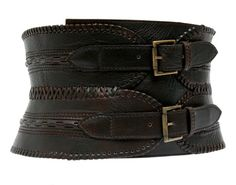 Wide leather belt. I wonder if this works like a corset...