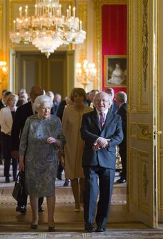 Queen Elizabeth II shows Irish President Michael D Higgins Irish related items from the Royal Collection, in the Green Drawing Room at Windsor Castle on April 8, 2014 in Windsor, England. This is the first official visit by the head of state of the Irish Republic to the United Kingdom.
