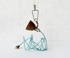 Vintage Industrial Light + Little Bell Clip Hanging Lamp with Aqua Net Color Cord. $260.00, via Etsy.