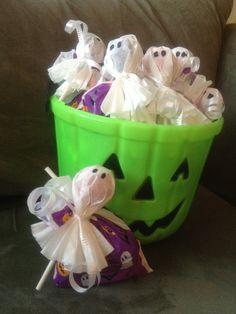 Halloween classroom kid treats with coffee filter ghost suckers.