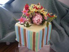 fruit cake , covered in fondant ,fondant stripes, gumpaste pink ice protea, sturt desert peas, christmas flowers & other Australian wildflowers....TFL !