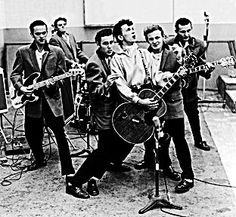 """Vincent Eugene Craddock (February 11, 1935 – October 12, 1971), known as Gene Vincent. His 1956 top ten hit with his Blue Caps, """"Be-Bop-A-Lula"""", is considered a significant early example of rockabilly. Known as the screaming end, his band would often end their act by rolling the drum kit across the stage and kicking over the amps. Something a band called the WHO emulated many years later. He died in a car crash in England along with Eddie Cochran."""