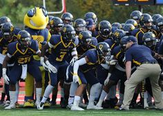 Members of the Rochester Community & Technical College football team prepare to take the field against Northwest Mississippi Community College during the 2015 Mississippi Bowl Dec. 6, 2015, at the