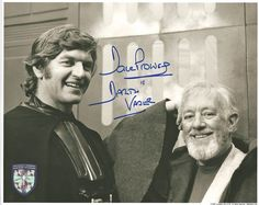 Dave Prowse signed this photo of Sir Alec Guinness and him on the Star Wars set.